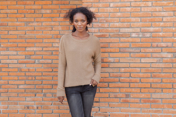 Camel colored lightweight sweater with ribbed neckline and cuffed sleeves