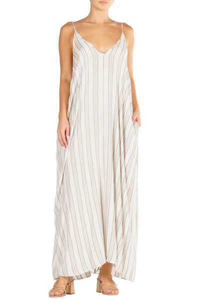 White flowy maxi dress with adjustable spaghetti straps, pockets, and a vertical striped detail