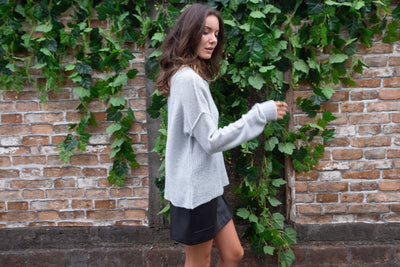 Grey lightweight sweater with ribbed neckline and cuffed sleeves