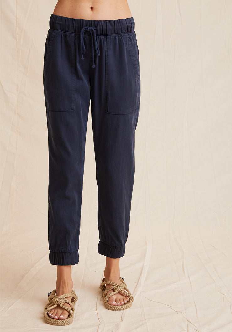 Everyday jogger in navy color with tie waist, cuffed bottoms, and pockets
