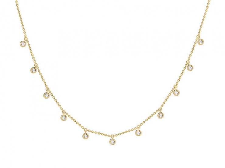 Gold necklace with diamond studs dangling down from chain