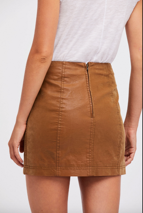 Back view of woman wearing chestnut brown vegan suede mini skirt with zipper closure