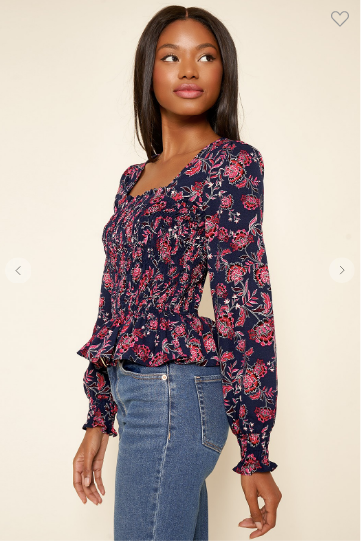 Navy and magenta floral top with square neckline, smocking detail, and slight peplum style