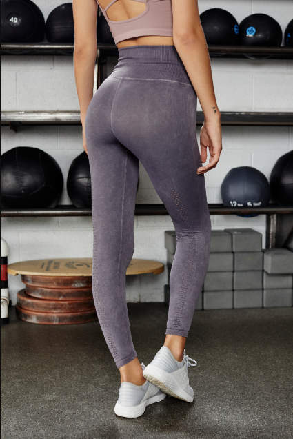 Washed grey athletic leggings with a thick ribbed waistband