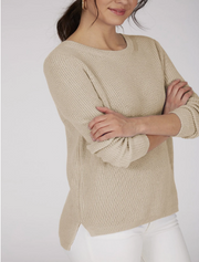 Light tan colored crewneck sweater with cute stitching and a shorter hem in the front