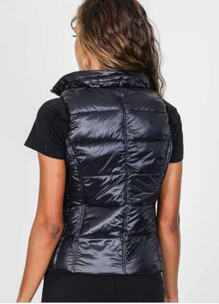 Back view of black puffer vest with a collar