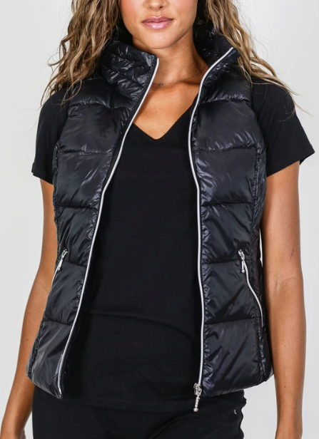 Woman wearing a water resistant black puffer vest