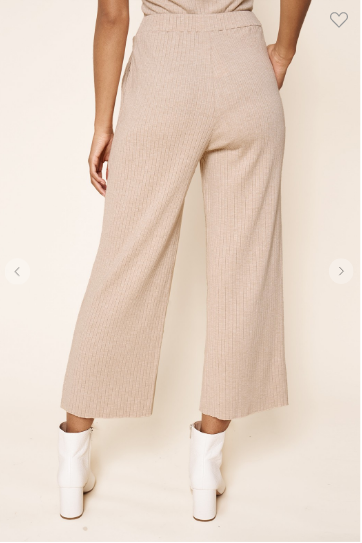 Back view of woman wearing high waisted ribbed knit wide leg pants