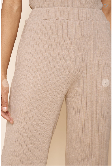 Close up of latte colored ribbed knit pants