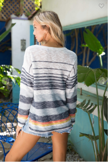 Back view of multi-striped beach sweater