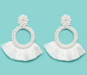 White colored circular earrings with fringe that comes off the earring