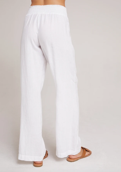 Back view of sheer white flowy linen pants