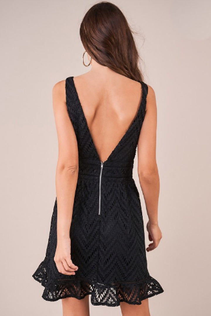 Back view of plunging v neck dress in black crochet