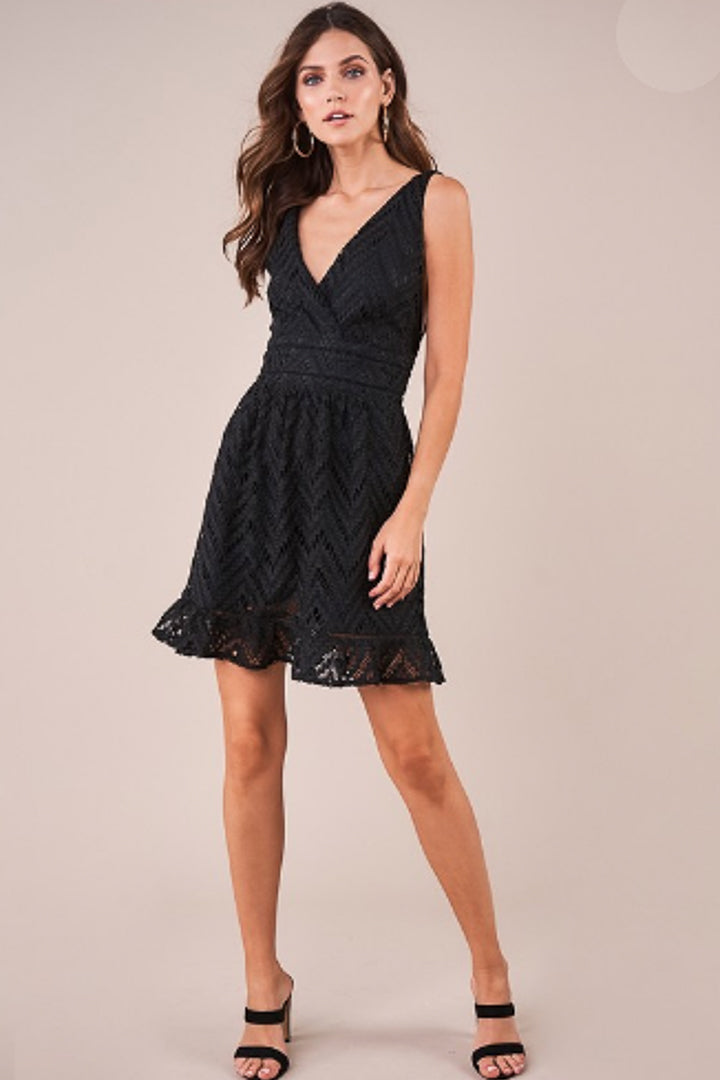 Black crochet lace plunging v neck dress with a cinched waist and skater bottom