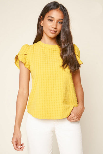 Mustard yellow short sleeve top with v back and a bow in the middle with tulip detail sleeves