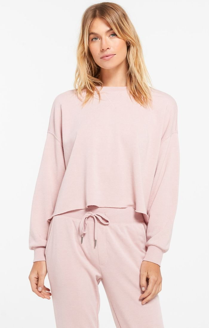 Pink long sleeve pullover in french terry fabric