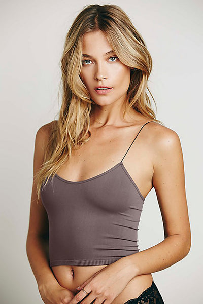 Form fitting bra-cami top with skinny straps and a ribbed detail at the bottom in a charcoal grey