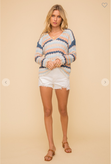 woman wearing striped beach pullover sweater