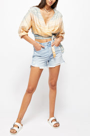 High rise distressed and slouchy light wash jean shorts