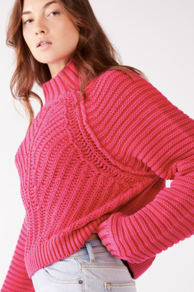 Mock neck slightly oversized knit sweater in hot pink