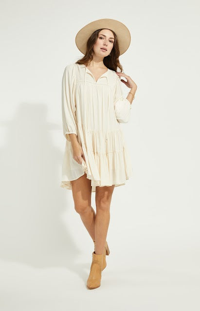 Cream colored boho styled dress with a loose fit and puffed sleeves