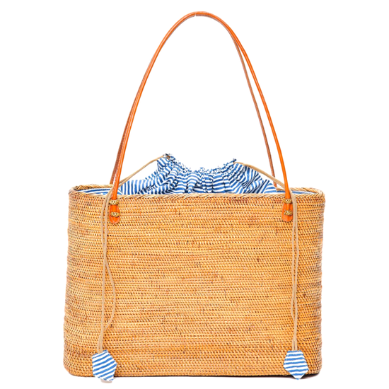 Rattan woven straw tote bag with orange stripes and a navy stripe interior