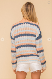 woman wearing peach and navy striped sweater