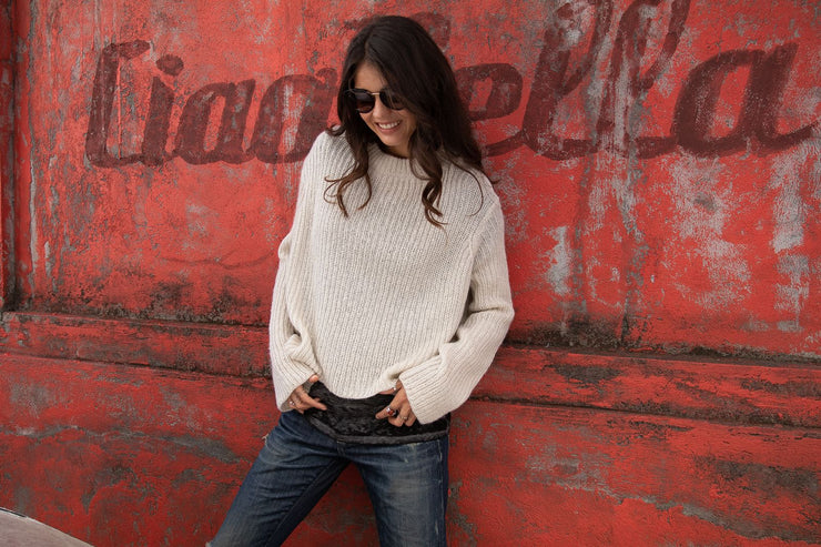 Neutral colored knit sweater with ribbed detailing