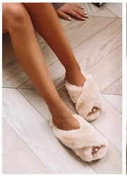 Neutral colored fur slip on slippers with open toe detail