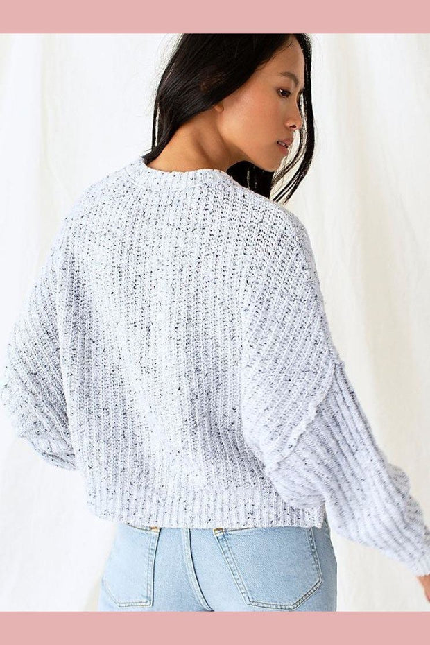 Grey sweater pullover with loose sleeves and cable knit detail