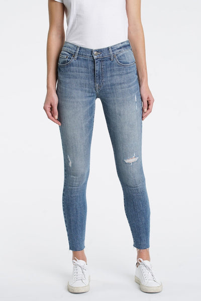 Light wash high waisted skinny jeans with minimal distressing and a raw hem at the ankle