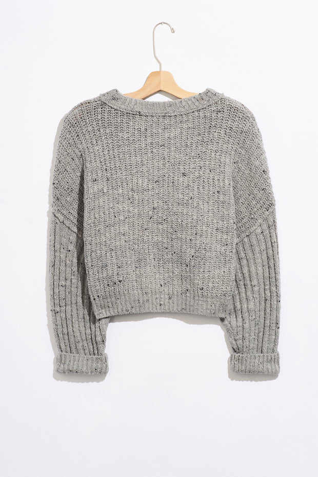 Grey pullover sweater with a scoop neckline loose sleeves and a cable knit detail