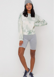 Woman wearing sage green tie dye crewneck sweatshirt