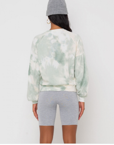 Back view of woman wearing sage green crewneck sweatshirt