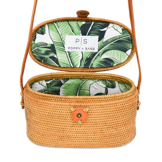 Oval shaped top-close style straw rattan lined with palm leaf print