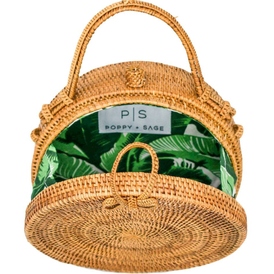 Close up of straw rattan circle bag lined with palm leaves