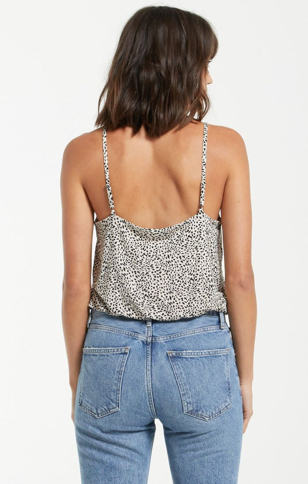 Back view of woman wearing spaghetti strap leopard print tank top with elastic and slouchy hem