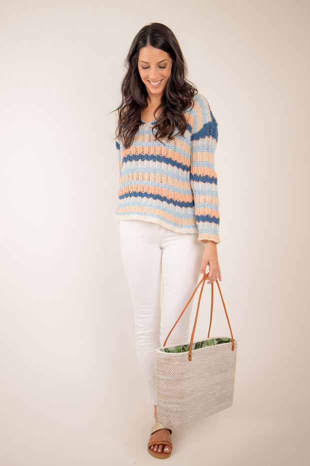 spring striped pullover sweater with denim jeans
