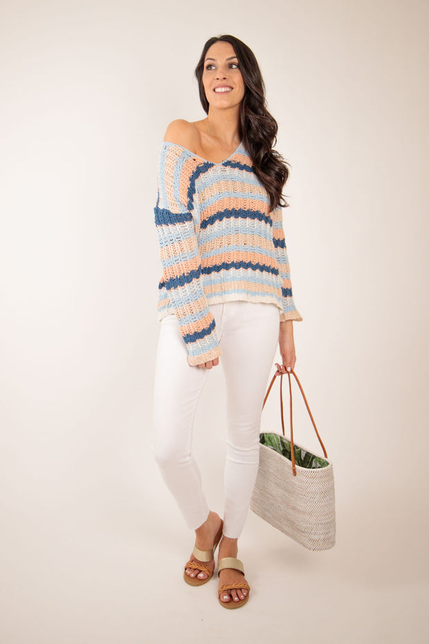 off the shoulder striped beach sweater paired with white denim