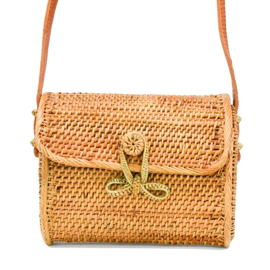 Handwoven crossbody bag with a bowtie clasp