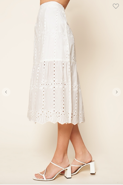 Side view of white embroidered eyelet midi skirt