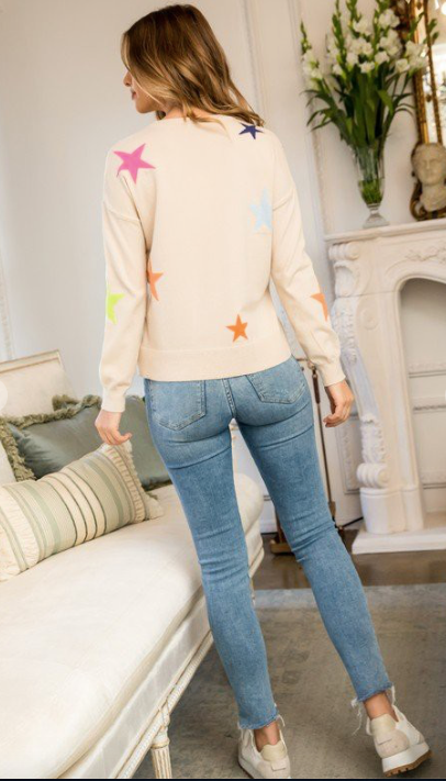 Back side of the neutral sweater with bright stars