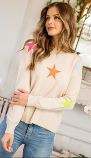 Front angle of neutral sweater with bright stars