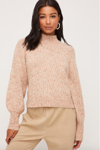 Taupe colored mock neck sweater with confetti specks all over