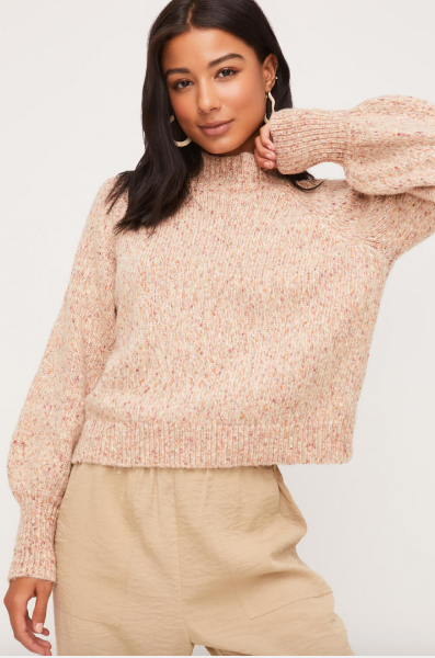 Mock neck speckled knit sweater with taupe hues and ribbed detailing on the neck and sleeves