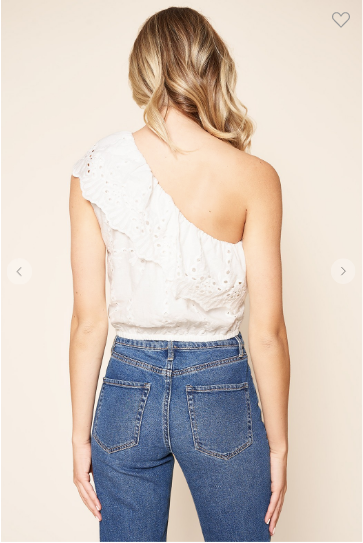 Back view of woman wearing the embroidered eyelet one shoulder top