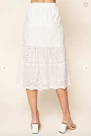 Back view of white embroidered eyelet midi skirt