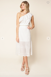 Woman wearing white embroidered eyelet tiered midi skirt