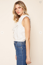 Woman wearing one shoulder embroidered eyelet top