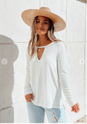 White ribbed long sleeve top with front key hole detail